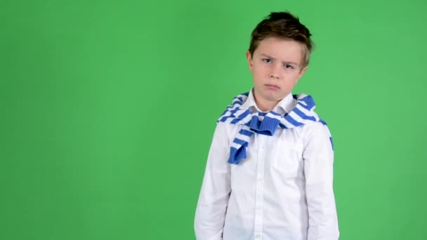 Young handsome child boy shakes his head on rejection - green screen - studio