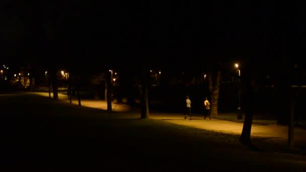 Athletes (runners) running in night park
