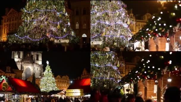 4k montáž (4 videa) - vánoční trhy s lidmi - svítící strom - lidí, kteří jdou na Staroměstském náměstí - Praha, Česká republika - prosinec 2013