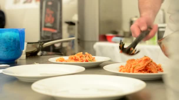chef prepares food - tomato and spinach pasta