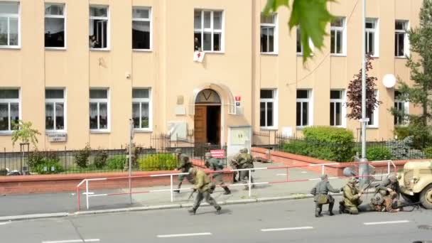 PRAGUE, CZECH REPUBLIC - MAY 2, 2015: reenactment performance battle of World War II on the street - soldiers shooting at each other - retreat of soldiers