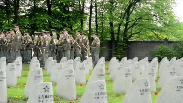 PRAGUE, CZECH REPUBLIC - MAY 2, 2015: Cemetery - gravestones - World War II and group of military musicians