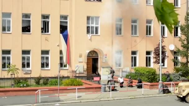 PRAGUE, CZECH REPUBLIC - MAY 2, 2015: reenactment performance battle of World War II on the street - soldiers shooting at each other