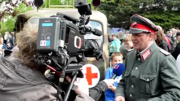 PRAGUE, CZECH REPUBLIC - MAY 2, 2015: TV doing an interview with a soldier (World War II)