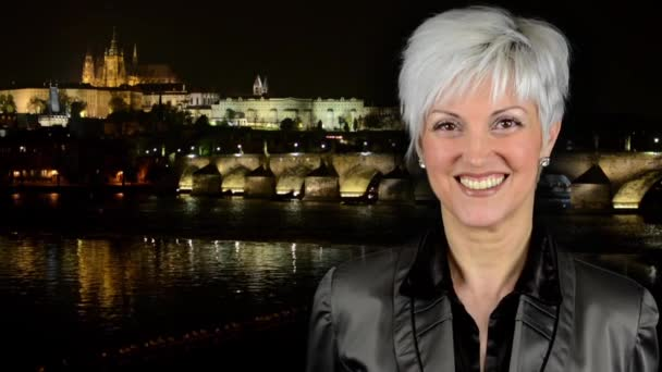 business middle aged woman smiles - night city - Prague, Czech Republic - Prague Castle (Hradcany) - Charles bridge