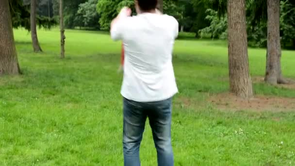 Father rotate with daughter (cute girl) around - park