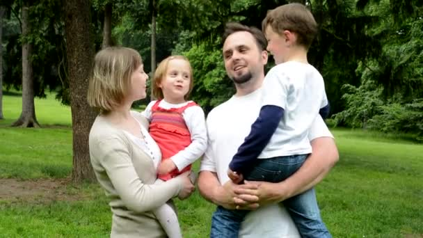 Family Middle Couple In Love Cute Girl And Small Boy Give A Kiss