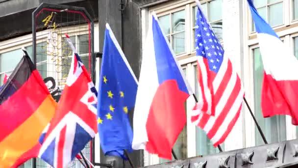 flags on the building - wind - UK, France, USA, EU, Czech Republic etc.