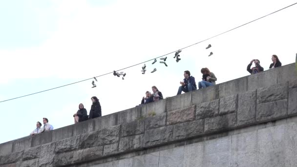 PRAGUE, CZECH REPUBLIC - MAY 30, 2015: tourists look at the city - people take pictures of the city - hanging shoes on power cable