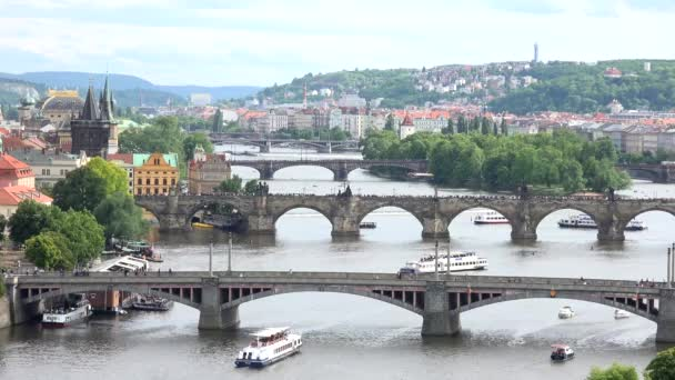 Prague - Charles bridge with walking people and other bridges - Vltava river with boats