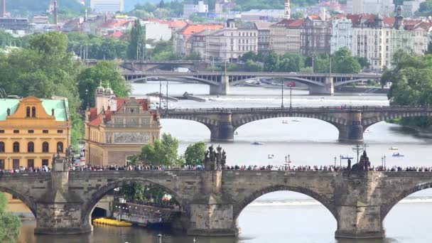 Prague - Charles bridge with walking people and other bridges - Vltava river with boat