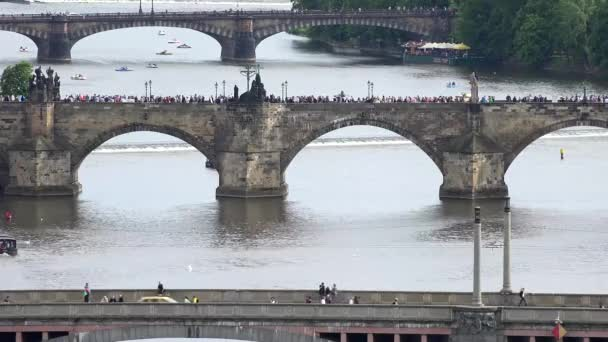 Prague - Charles bridge with walking people and other bridges - Vltava river