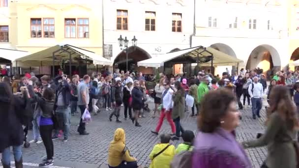PRAGUE, CZECH REPUBLIC - MAY 30, 2015: city - Old Town Square with buildings and walking people - travelers look at historic building - in front of Astronomical clock - city
