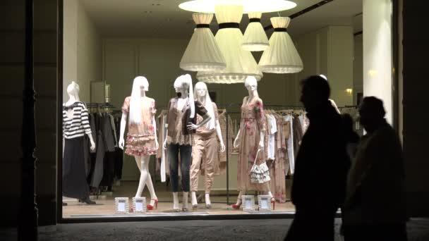 c8fdd6e75e8 Clothing store - shop window - urban street with walking people - night–  stock footage