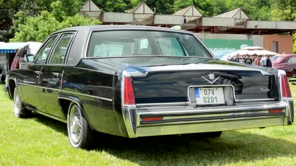PRAGUE, CZECH REPUBLIC - JUNE 20, 2015: old vintage American car - black Cadillac - back side