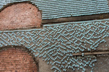 Ruined brick wall covered with fake banknotes of dollars in Flor
