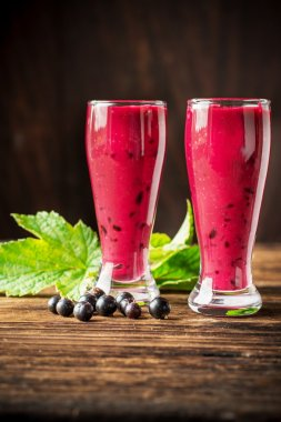 Two glass glasses with black currant smoothie