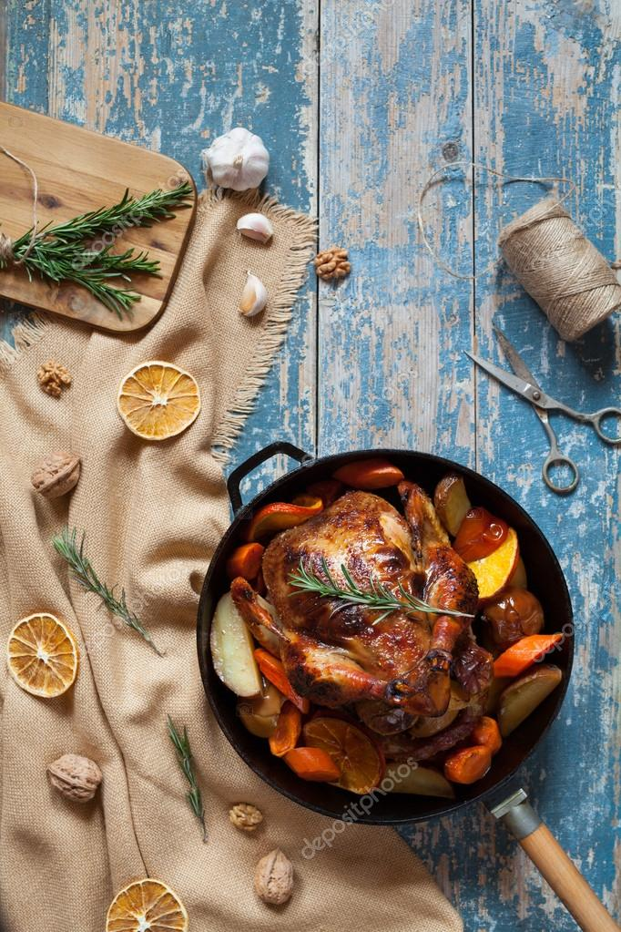 Roasted chicken stuffed with various vegetables and spices