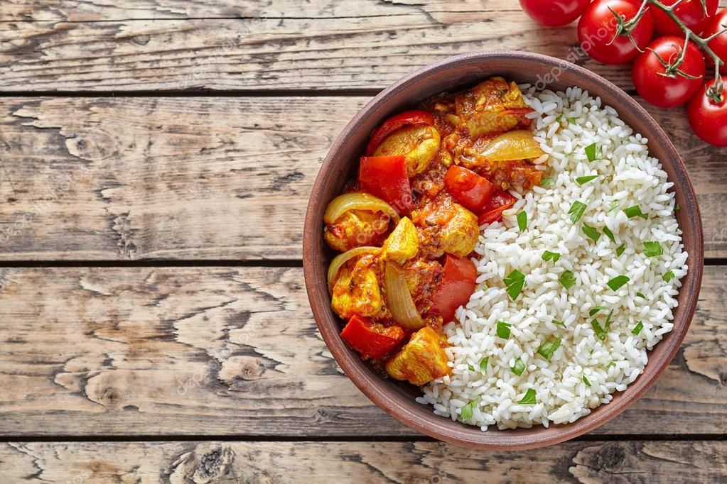 Chicken jalfrezi traditional indian spicy curry chilli meat with chicken jalfrezi traditional indian spicy curry chilli meat with basmati rice and vegetables healthy dietetic asian food in clay dish on vintage table forumfinder Choice Image