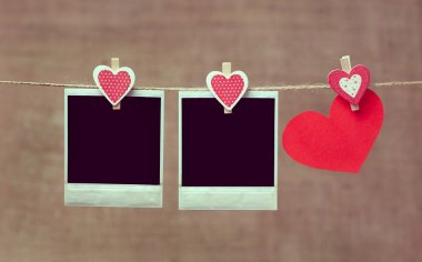 Two polaroid photo frames and heart for valentines day with vint