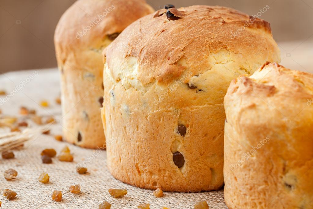 Tasty homemade panettone easter cake sweet dessert bread with raisins on textile