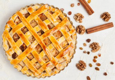 Uncooked homemade rustic apple pie preparation greased with egg yolk