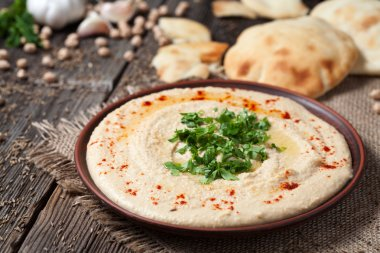 Hummus traditional Jewish creamy lunch salad with chickpeas, olive oil and paprika