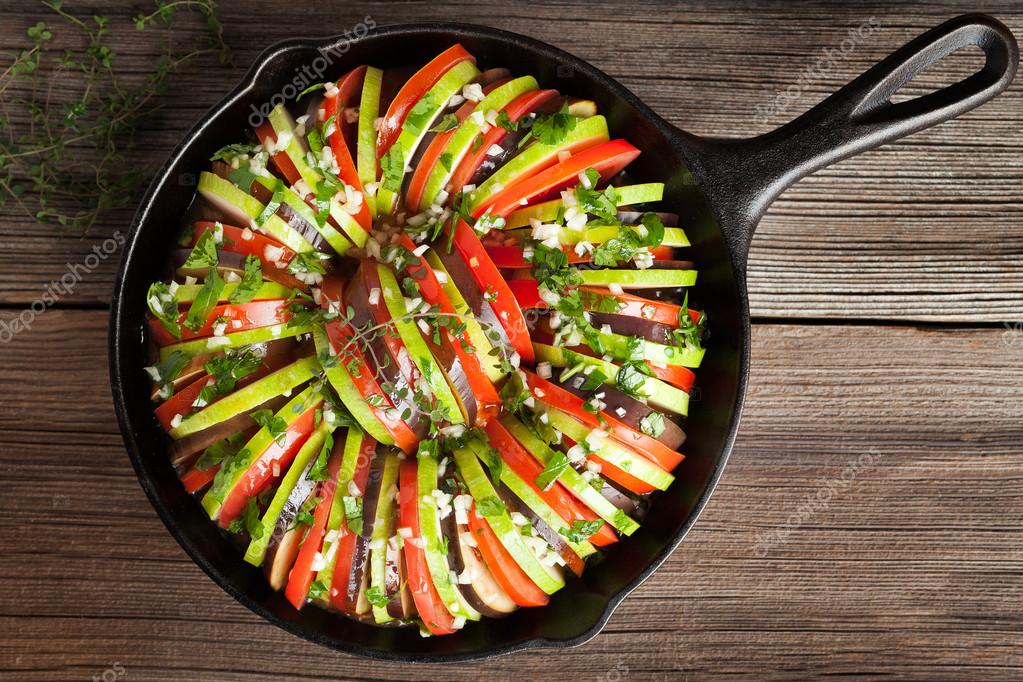 Traditional raw vegetable ratatouille in cast iron pan preparation traditional raw vegetable ratatouille in cast iron pan preparation recipe homemade healthy vegetarian food on vintage forumfinder Images