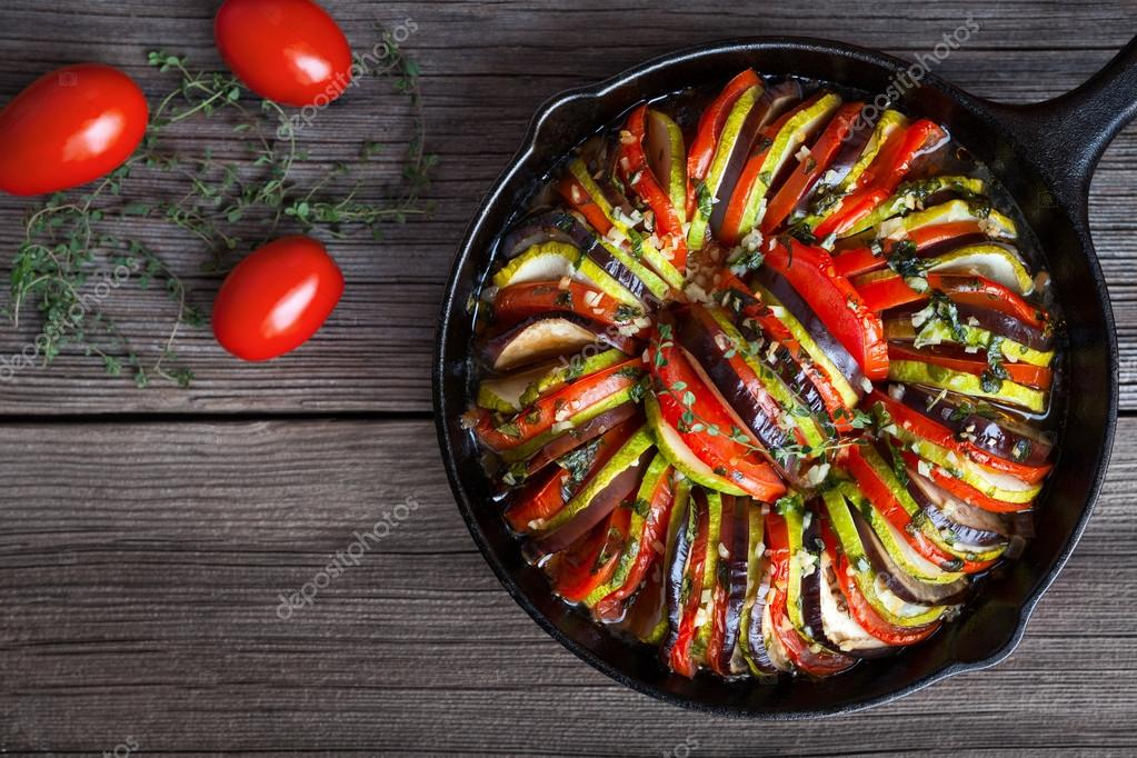 Vegetable ratatouille baked in cast iron frying pan homemade vegetable ratatouille baked in cast iron frying pan homemade preparation recipe healthy diet french vegetarian food forumfinder Choice Image