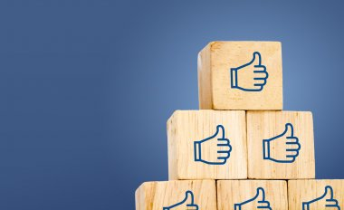 Thumb up icon on wood cubes