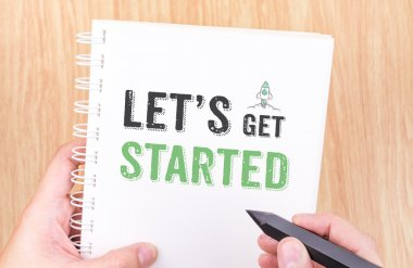 Let's get started word on white ring binder notebook with hand h