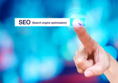 Finger touch on search button with search bar and SEO (Search en