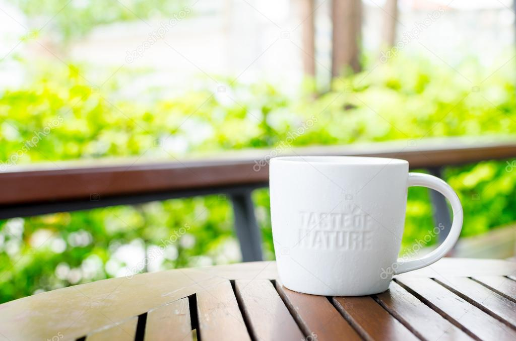 White ceramic mug with stamp word