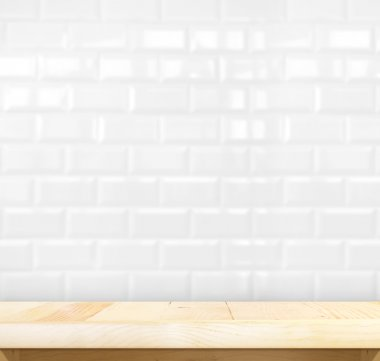 table and white ceramic brick wall