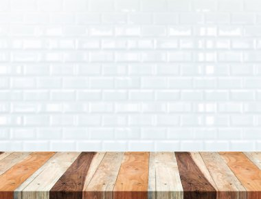 Empty tropical wood table and blur white ceramic tile brick wall