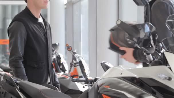 Seller gives motorbike helmet to the buyer