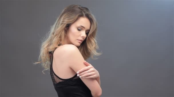 Side view of a girl stroking her arm