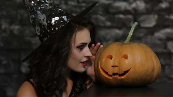 Woman-sorceress makes a gesture shh