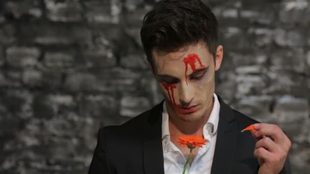 Vampire tells fortunes tearing petals