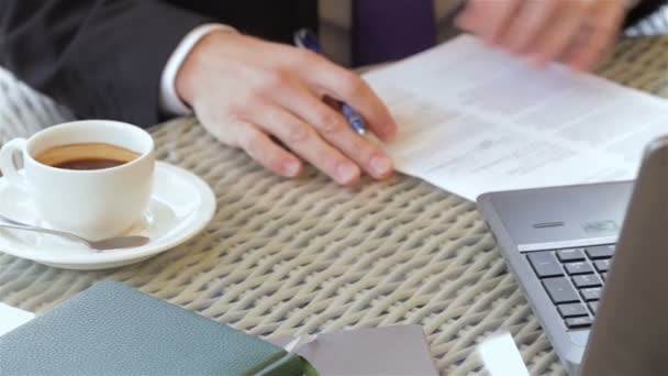 Signing a contract during a coffee break