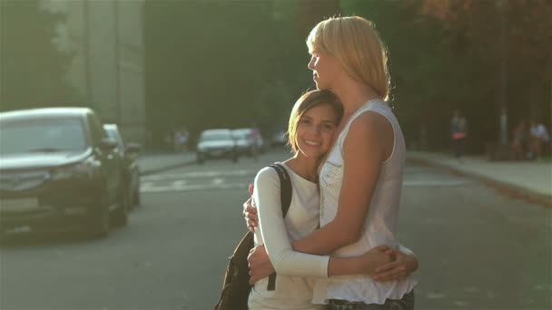 Standing in an embrace on the road