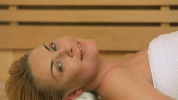 Woman relaxing at the sauna