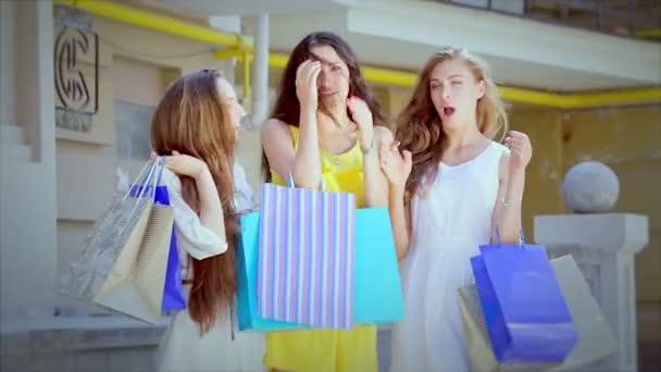 Three cute girls walking along the fashionable boutiques