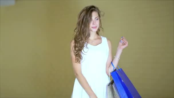 Beautiful young smiling girl shopaholic posing