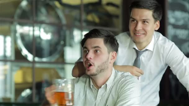 Two successful friends businessmen drink beer and rejoice and shout together