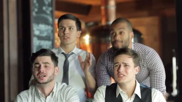 Successful businessmen friends having fun together in the bar