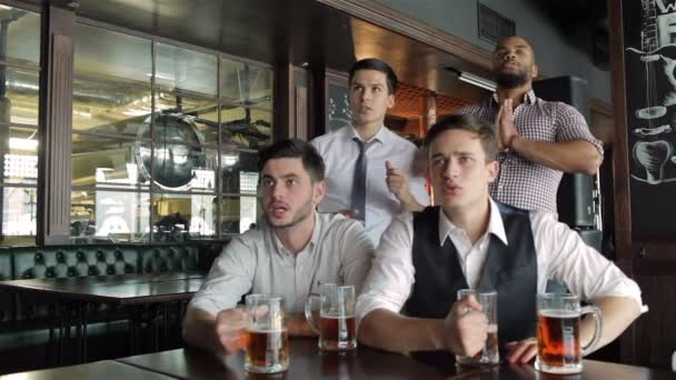 Four friends businessmen drink beer and rejoice