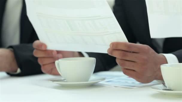 Handshake between two businessmen sitting