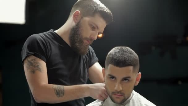 Mens hairstyling and haircutting in a barber shop