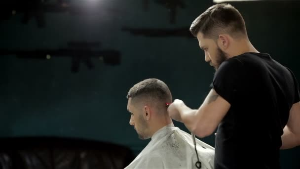 Young man having a haircut with a hair clippers
